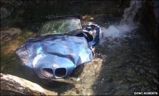 Car at bottom of ravine