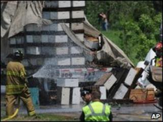 Firemen hose down bee hives spilled from lorry in Lakeville, Minnesota - 24 May 2010