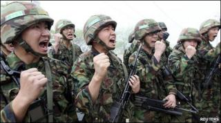 South Korean soldiers shout slogans before they conduct a military drill near the demilitarized zone (DMZ) separating South Korea from North Korea in Yanggu, about 180 km (112 miles) northeast of Seoul, May 24, 2010