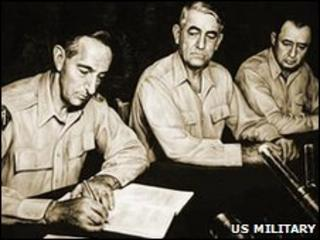 General Mark Clark signs the armistice agreement - picture from the US Military's Korean War Commemoration website
