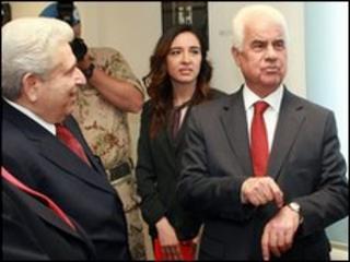 Cypriot President Demetris Christofias (left) with Turkish Cypriot leader Dervis Eroglu in Nicosia, 26 May 2010