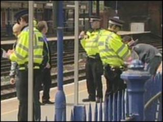 Police at Fleet railway station on Thursday