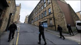 Police search an area of Bradford