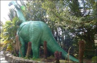 Model brontosaurus at National Showcaves Centre for Wales