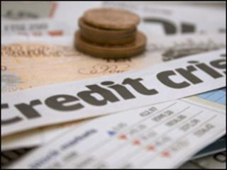 Credit crisis headline and coins