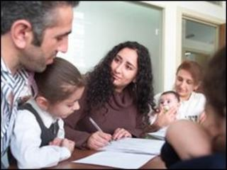 A family receiving legal advice