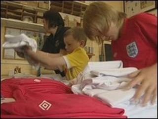 Bernie Roberts and her sons work on the England team's kit
