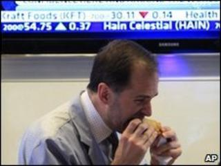 Trader eating lunch at NYSE