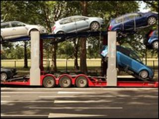Cars loaded on to transporting lorry