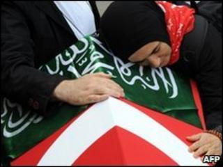 A widow of one of the activists mourns by his coffin at Fatih Mosque in Istanbul on 3/6/2010