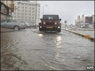 A car drives through flooded streets in Muscat, Oman 4 June