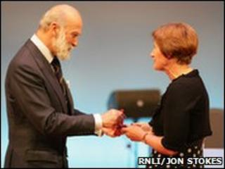 Prince Michael presents Gold Badge to Caryll McFadyen