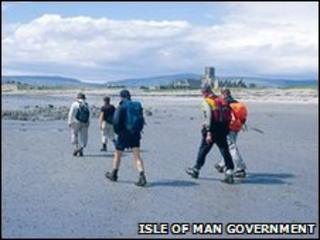 Walkers on Castletown beach