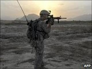 A US soldier on patrol outside Kandahar, 17 May 2010