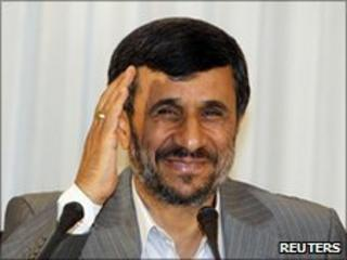 Iranian President Mahmoud Ahmadinejad gestures after his news conference in Istanbul
