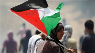 Palestinian and foreign peace activists attend a demonstration in the Israeli-occupied West Bank
