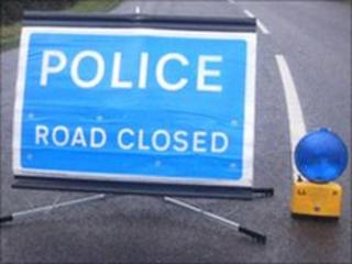Road closed as car goes over cliff