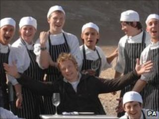 Chef Jamie Oliver with staff at his Fifteen restaurant in Cornwall