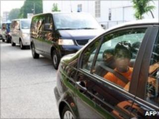 Convoy transferring alleged Somali pirates to Germany, 10 Jun 10