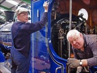 Murray Duncan and David Mitchell make finishing touches to locomotive. Pic: Strathspey Railway Company