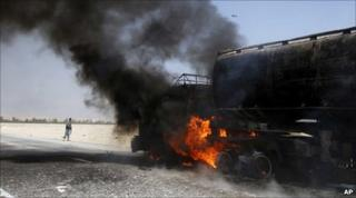 A Nato fuel tanker burns after a roadside bomb attack east of Kabul, 11 June
