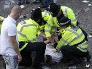 Police arrest a spectator at Castlefield Arena