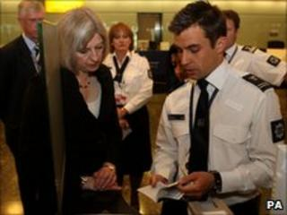 Theresa May meeting security staff at Heathrow airport