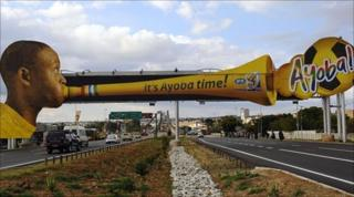 Advertising billboard showing a man blowing a vuvuzela, in Polokwane, South Africa, on 31/5/2010