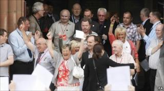 Relatives of those killed on Bloody Sunday leave the Guildhall in Derry after reading the findings of the Saville Inquiry.
