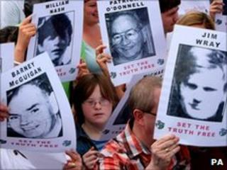 Campaigners hold posters of the Bloody Sunday victims