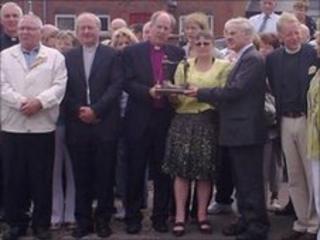 The leaders met the families at the memorial in Bogside