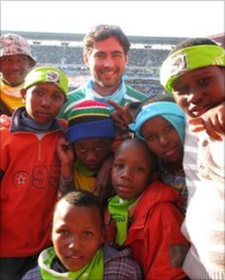 Samuel Mayer with children at World Cup match