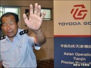 A security guard at the Toyoda Gosei plant in Tianjin