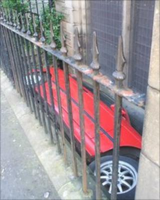 BMW car wedged between a wall and a railings (Pic: Catherine Cameron)
