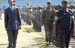 Rwandan President Paul Kagame inspects a military parade in Kigali