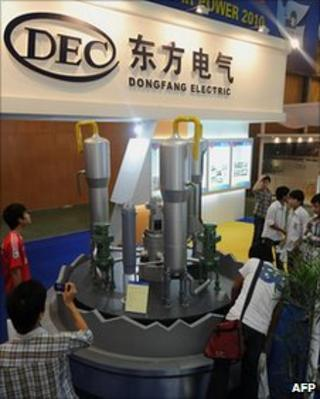 A Chinese energy company displays a model of a nuclear reactor at a show in Vietnam