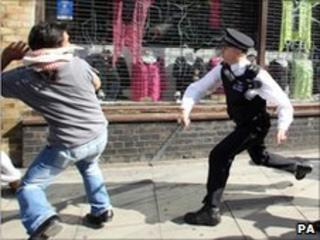 A policeman confronts a man