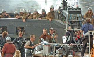 Russell Crowe (centre wearing sun glasses) filming Robin Hood in Pembrokeshire