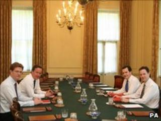 David Cameron, George Osborne, Nick Clegg and Danny Alexander in the Cabinet room at No 10 Downing Street