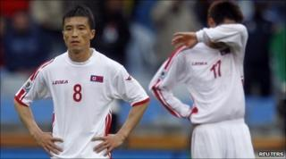 North Korea's Ji Yun-nam (L) and An Yong-hak at the final whistle