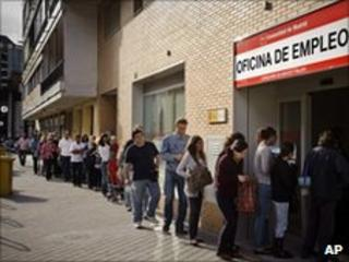 Unemployed workers in Spain queuing outside a job office