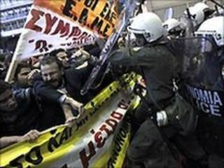 Protestors clash with riot policemen in front of the Greek finance ministry - 29 April