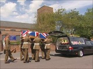 Cpl Webster's coffin being carried to the hears