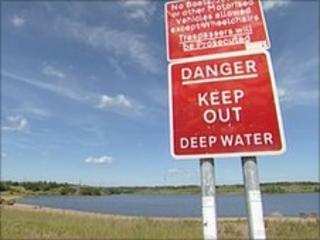 Danger sign at lake