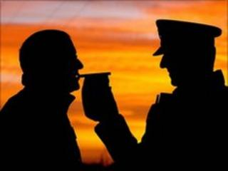 Motorist gives breath test on breathalyser