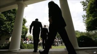 President Barack Obama followed by Gen David Petraeus and Defense Secretary Robert Gates