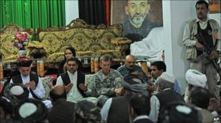 General Stanley McChrystal (third from left) with Afghan President Hamid Karzai (left) and tribal leaders in Kandahar on 13/6/2010
