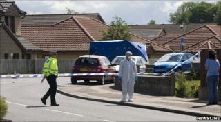 Elgin police probe scene [Pic: Newsline Scotland]