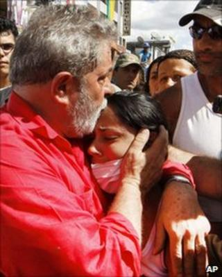 President Lula comforts a flood victim