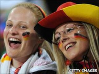 German football fans cheer duirng the the Group D, first round. 13 June 2010